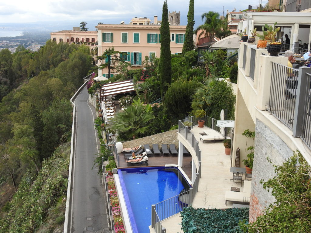 Up market accommodation at Taormina with a pool on the cliff side.