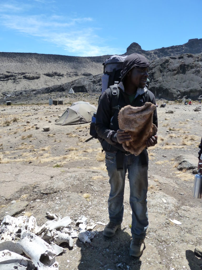 Solomon the singing Assistant Guide while we were Climbing Mt Kilimanjaro