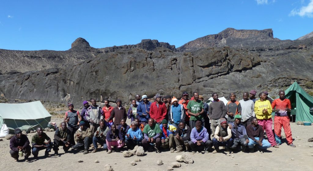 Climbing Mt Kilimanjaro guides, porters and cooks - our amazing support team