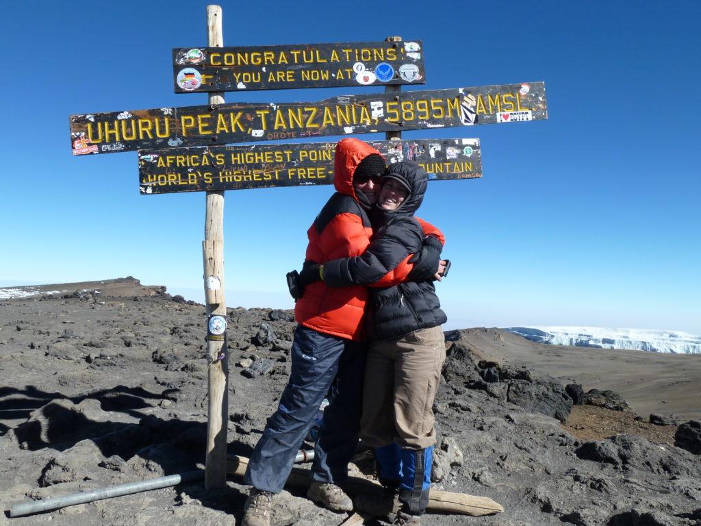 Climbing Mt Kilimanjaro - a hug at the summit