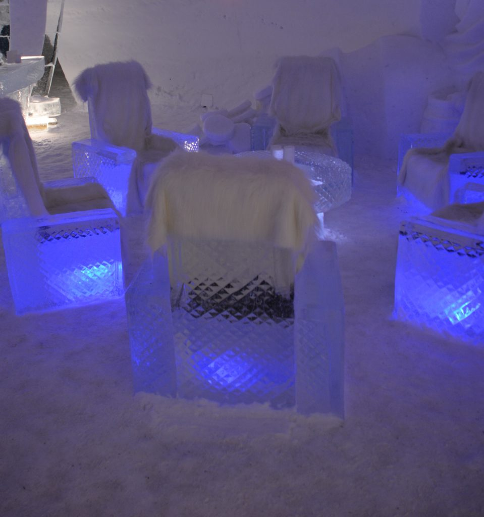 Ice lounge at the Snowhotel, Kirkenes, complete with sheep skin covers.