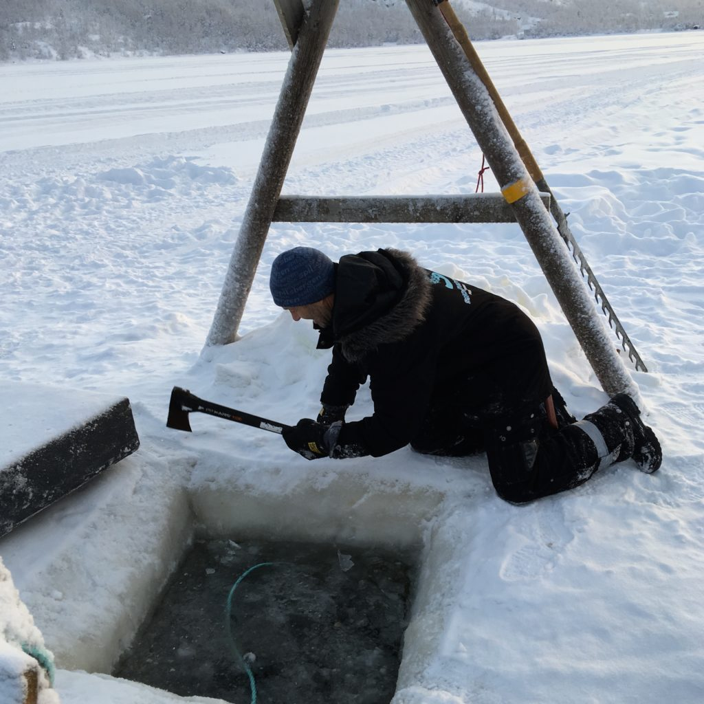 The ice hole (Finland) to put the trap into for Arctic King Crab is cut with a chainsaw. Later an axe is used to chip away were needed.