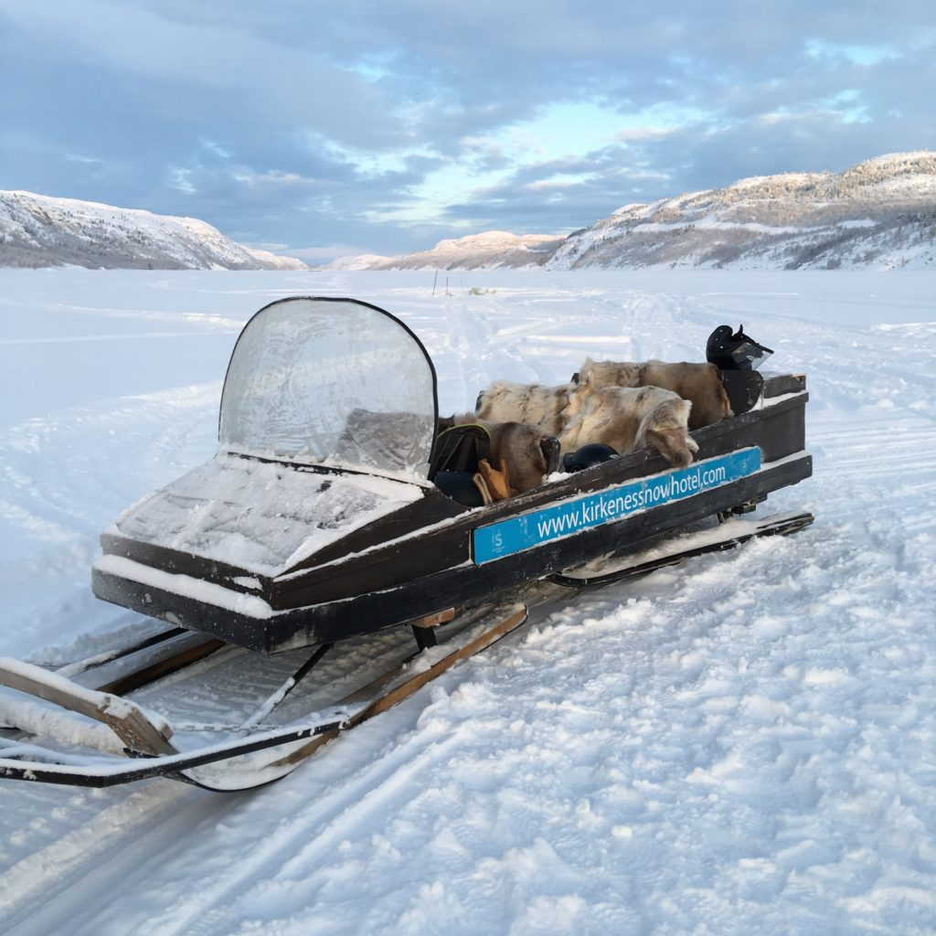 Sledge towed behind Snowmobile to reach the Arctic King Crab fishing hole. Reminder skins on seats helped to keep backsides warm. Kirkenes, Finland.