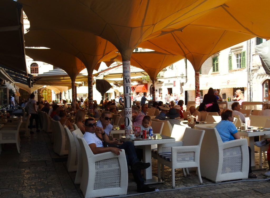 Busy cafes in the square at Kotor, Montenegro. www.gypsyat60.com