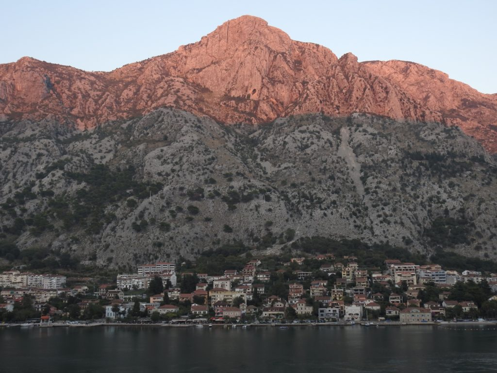 Sunset at Kotor starting to colour the mountains pink. www.gypsyat60.com