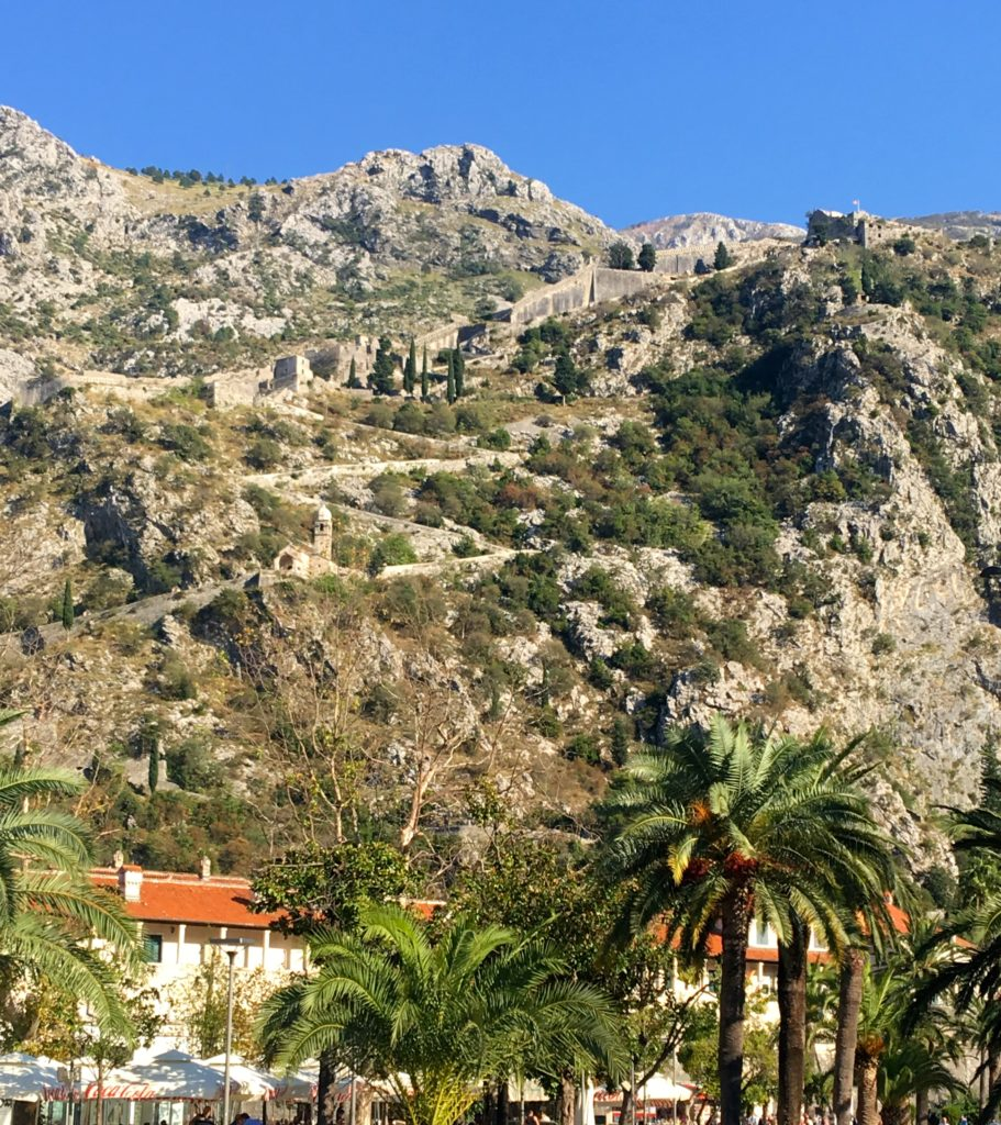 Looking up to St John's Fort from Kotor Town, Montenegro. There are 1,350 odd shaped steps to climb which takes about 2 hours round trip. www.typsyat60.com