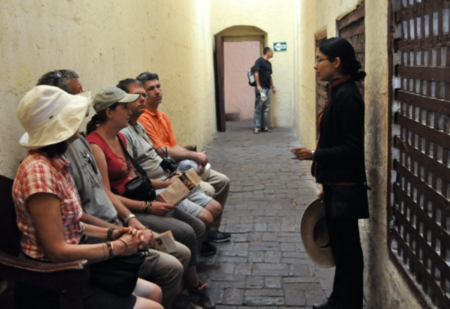 Tour Guide giving local knowledge at Saint Catalina Monastery, Araquipa, Peru, South America. www.gypsyat60.com