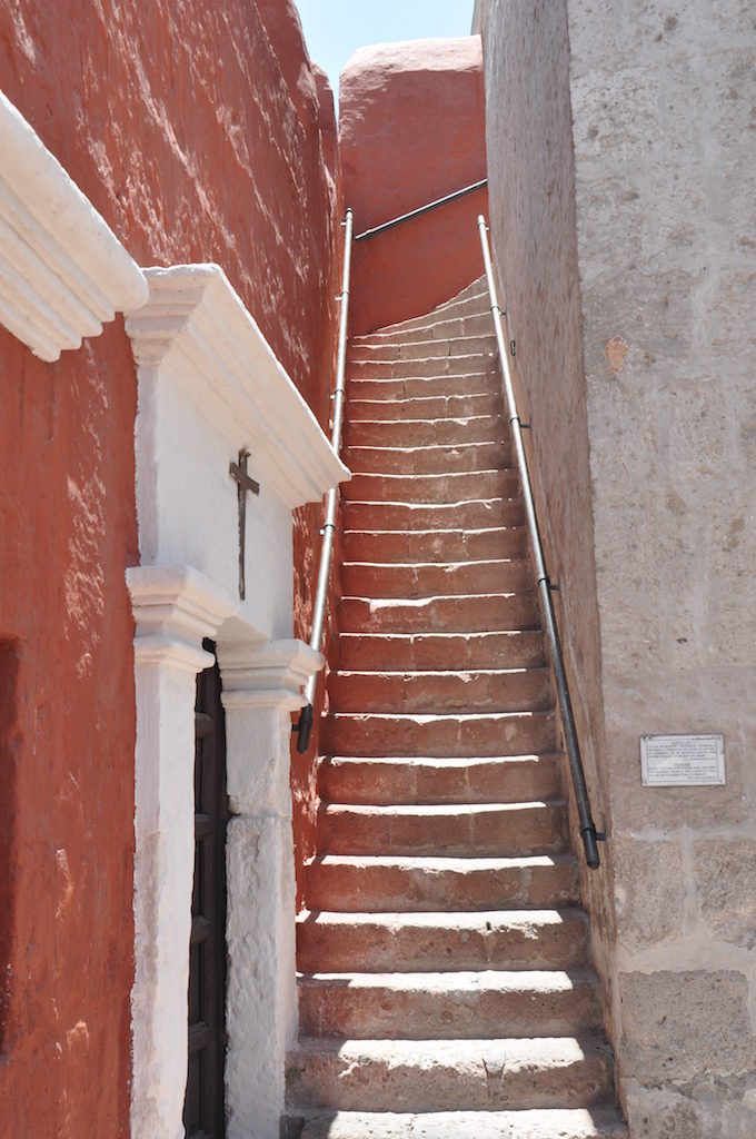 Stairway to the top of the church wall at Saint Catalina Monastery, Araquipa, Peru, South America. An amazing view of the mountains, the monastery and the city beyond awaits. www.gypsyat60.com