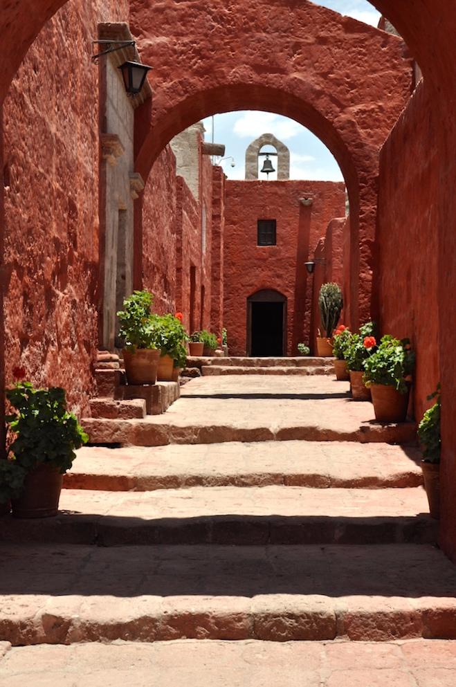 Toledo Street with vivid orange walls, Santa Catalina Monastery, Arequipa, Peru, South America. www.gypsyat60