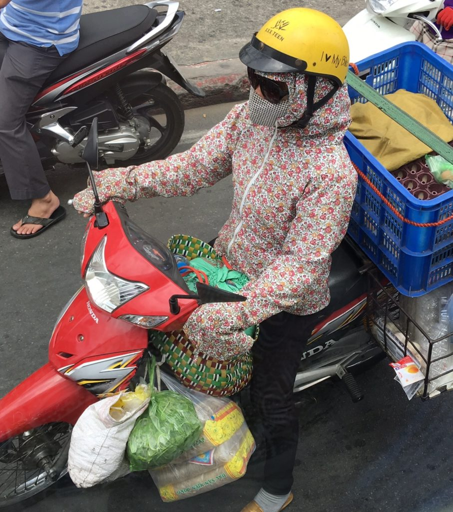 Fashionable Lady Motorbike Rider - Ho Chi Minh. Every part of her body covered (summer and winter). www.gypsyat60.com