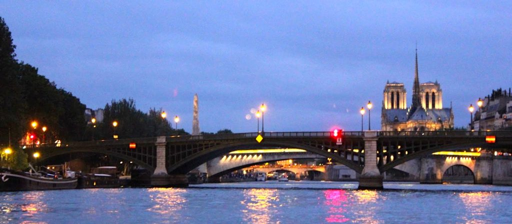 The River Seine, Paris, taken from boat level at night.
