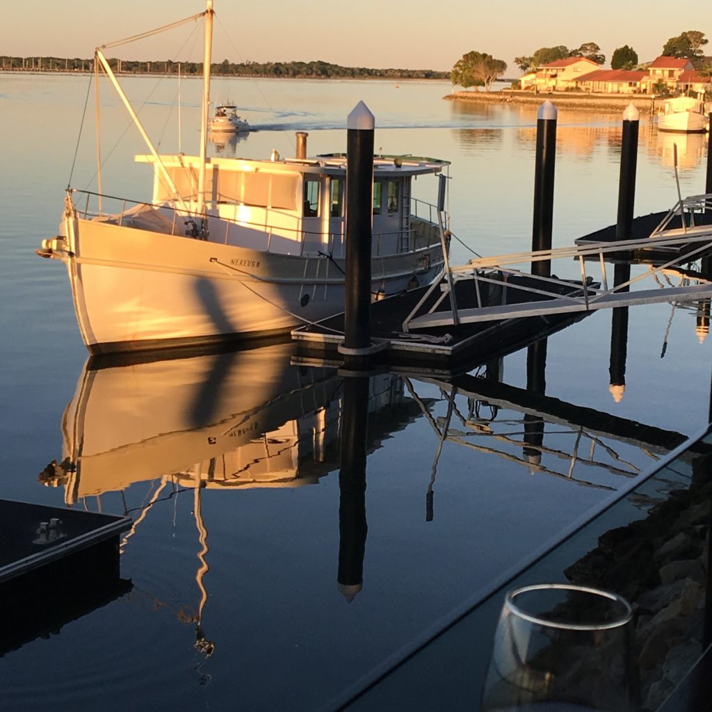 Sunset at the Yamba Shores Tavern. Sitting on the deck enjoying the reflection with a glass of wine. www.gypsyat60.com