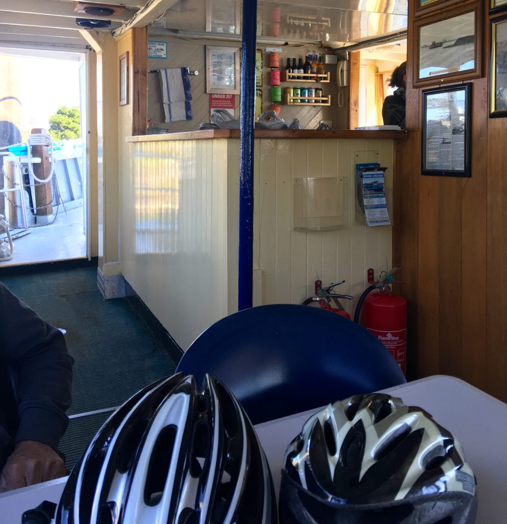 Catching the ferry from Yamba to Iluka, New South Wales, Australia. Both famous fishing villages. Bikes on board. Lots of pictures around the walls of days gone by. www.gypsyat60.com