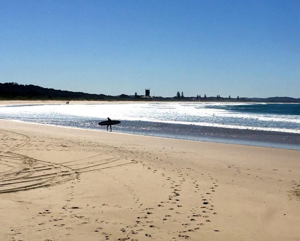 Lone surfer at Angourie Beach, New South Wales, Australia. www.gypsyat60.com